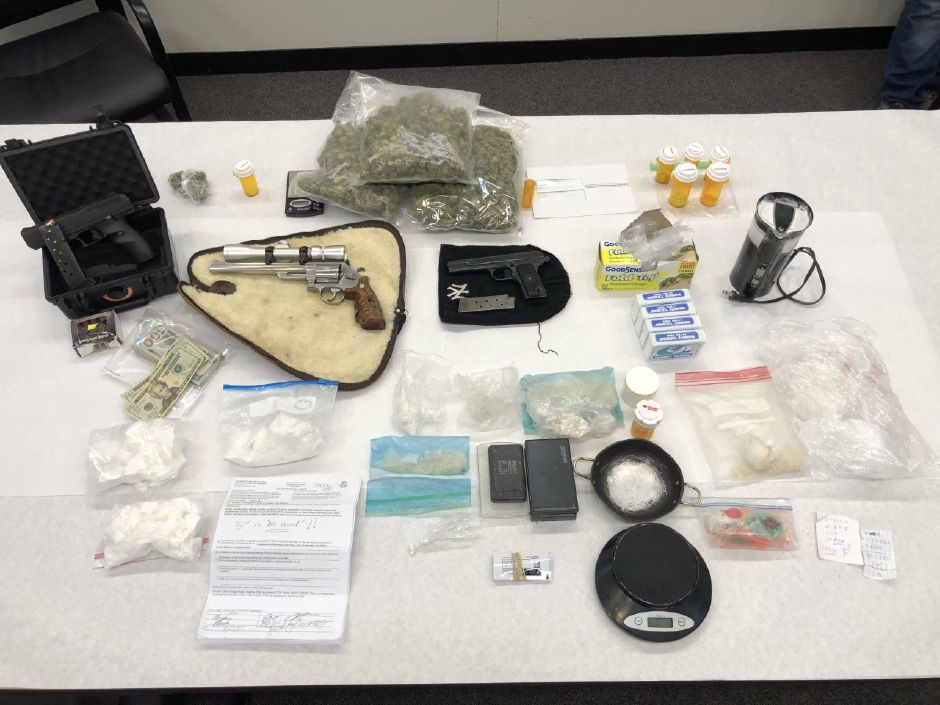 Items seized from an Arch Street residence Tuesday night, included drugs, weapons, ammunition, a scale and other items.