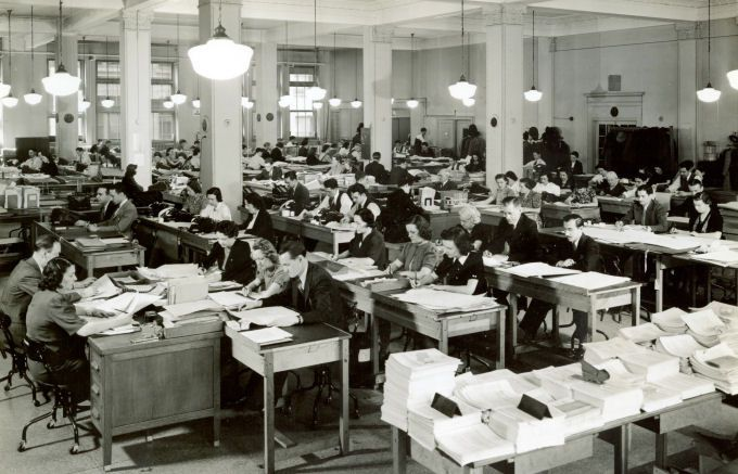 U.S. Census Bureau employees work on the 1930 census records.