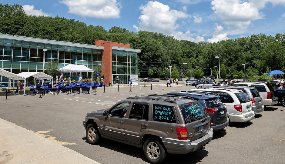 Families watch from their vehicles during graduation ceremonies at H.C. Wilcox Technical High School in Meriden, Mon., Jun. 22, 2020. Dave Zajac, Record-Journal