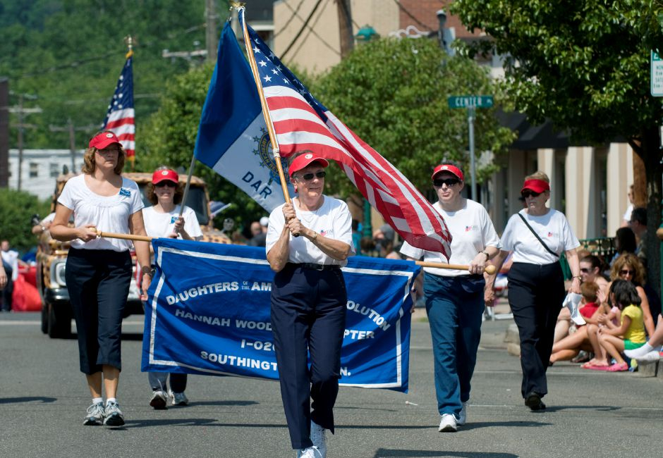 Susan Rosi (center), Historian of the Daughters of the American Revolution Hannah Woodruff Chapter, holds the American flag and leads the chapter in the Memorial Day Parade in Southington, May 28, 2012. (Sarah Nathan/Record-Journal)