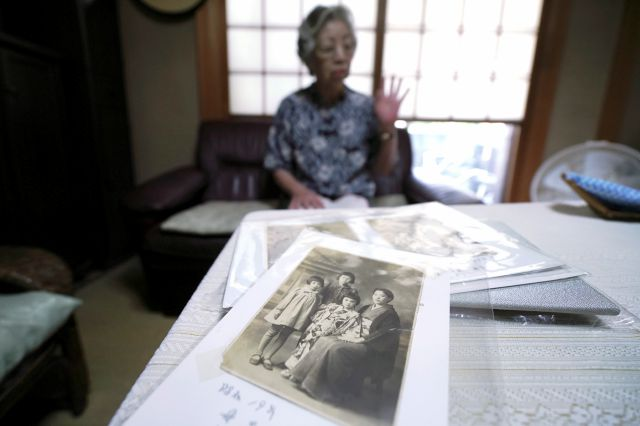 Mari Kaneda, a Pacific war orphan, speaks on her experience during an interview with The Associated Press Sunday, July 19, 2020, in Warabi, north of Tokyo. In Japan, war orphans were punished for surviving. They were bullied. They were called trash, sometimes rounded up by police and put in cages. Some were sent to institutions or sold for labor. They were targets of abuse and discrimination. Now, 75 years after the war