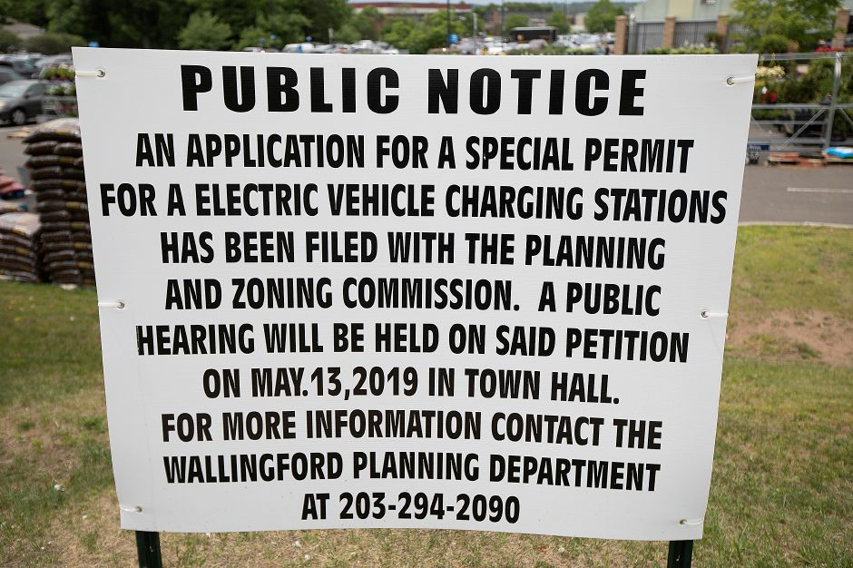 "A ""Public Notice"" sign posted for a special permit for electric vehicle charging stations at Walmart in Wallingford, Mon., June 10, 2019. Dave Zajac, Record-Journal"