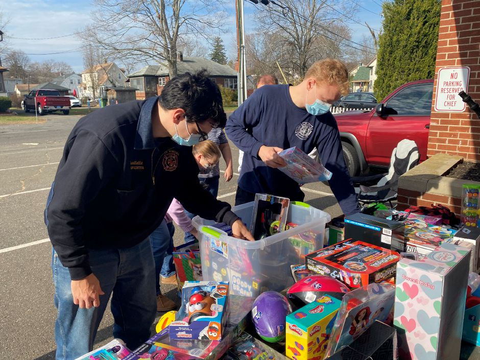 Stephen Ouellette, left and Ryan Larson, SMVFD volunteers unpack toys donated to South Meriden Neighborhood Association's Turkey and Toy Drive on Saturday, Nov. 21. Faith Williams.