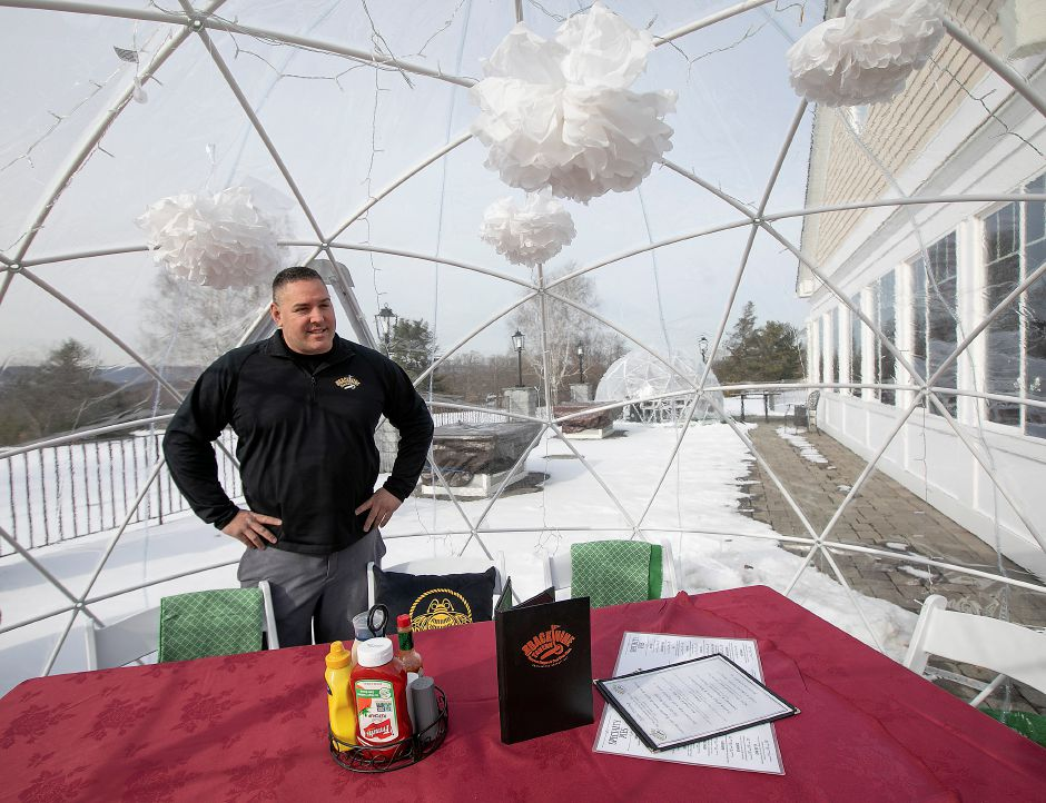 Pete McAloon, manager, talks about igloo dining at Back Nine Tavern at Southington Country Club.Dave Zajac, Record-Journal