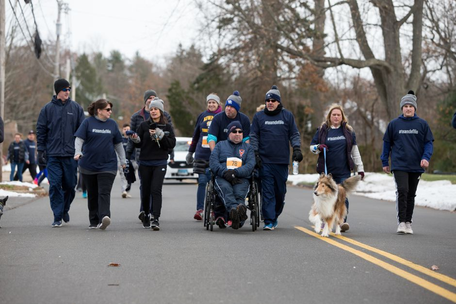 Scott DeFilio is pushed by friends Sunday during the Kiwanis Turkey Trot 5k and 5 mile at Stephens School in Wallingford November 18, 2018 | Justin Weekes / Special to the Record-Journal