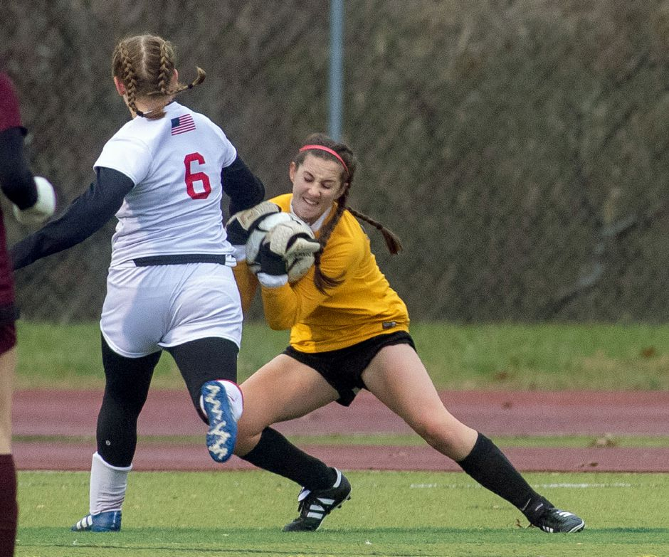 Sheehan goalie Beth Arnold corrals a loose ball before Branford's Melanie Sachs could  attempt  a shot during Tuesday's CIAC Class L girls soccer tournament game at Riccitelli Field. The Titans won the first-round game 2-1.