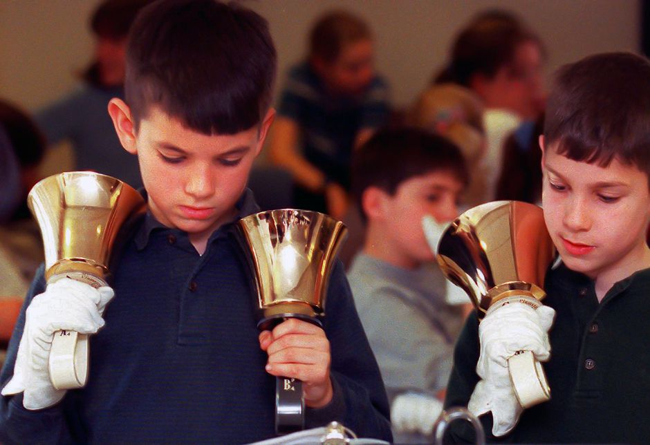 RJ file photo - Fourth-graders Dan Thomann, 10, left, and Matt Vitello, 9, were among the 31 fourth-, fifth- and sixth-graders from the Norton School Handbell Club performing for patiends at Gaylord Hospital in Wallingford, March 1999.