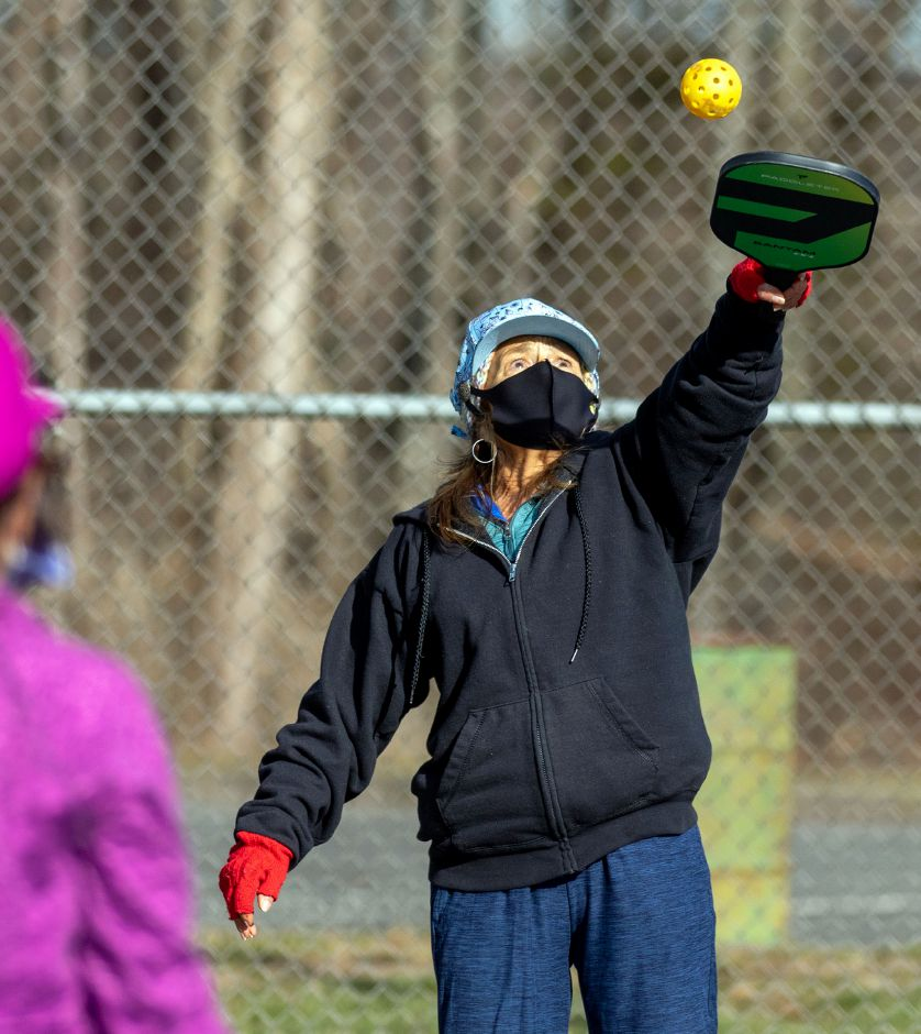 Donna DiNacole-Johnson, of Branford, returns the ball over the net during a game of pickleball at Harrison Park in Wallingford on Friday, Jan. 8, 2021. Aaron Flaum, Record-Journal.com