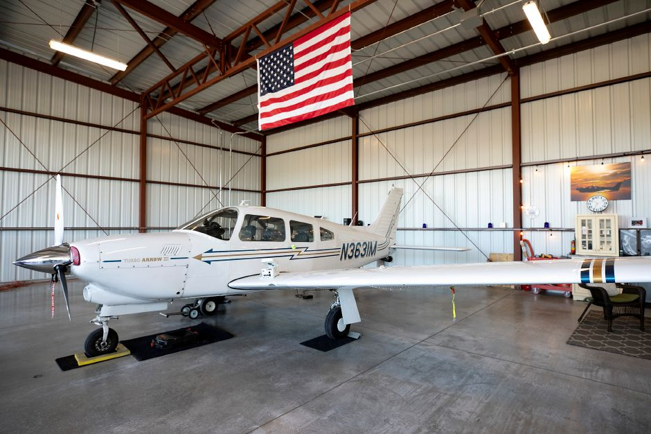 A Piper Turbo Arrow lll aircraft stored in a new hangar at Meriden Markham Airport, Fri., Oct. 9, 2020. City officials held a ribbon-cutting ceremony Friday morning for new aircraft hangars recently completed at city-owned Meriden Markham Airport. Dave Zajac, Record-Journal