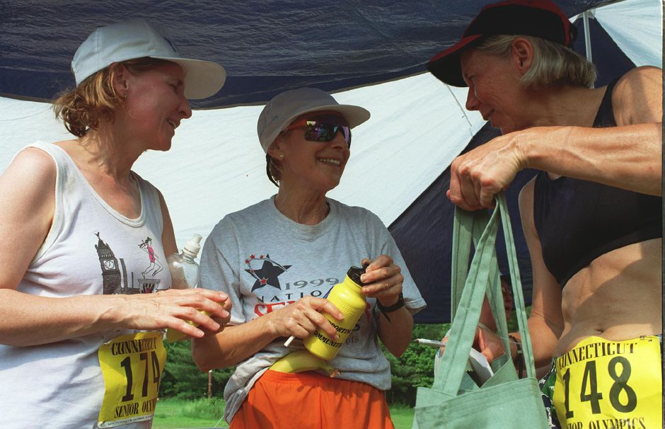 Sheila Morris, left, of Windsor Locks, Barbara Frasca, of Wethersfield, middle, and Janet Romayko, of East Hartford, right, cool off in the shade after participating in the Connecticut Senior Games in Southington Friday June 2, 2000. Romayko and Frasca won first place in her age group.