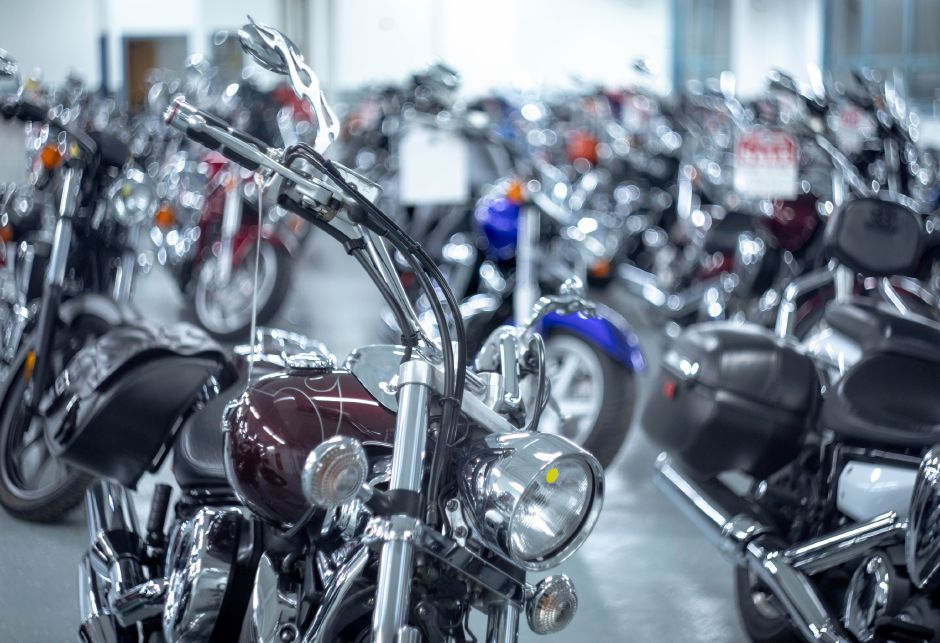 Motorcycles lined up at Powerhouse Motorsports after the Plainville business