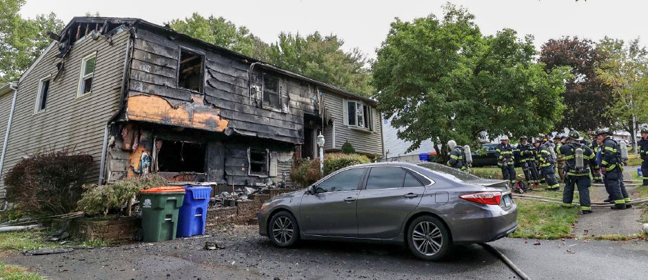 Meriden firefighters overhaul a home at 32 Spice Hill Drive after a fire damaged the home Monday Sept. 28, 2020. | Dave Zajac, Record-Journal