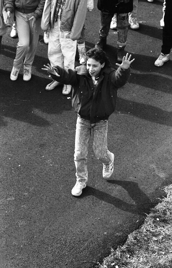 RJ file photo - Mike Mead, 11, reacts to seeing his egg successfully drop from the Cook Hill School roof as part of a project to design a container to protect eggs from the fall, March 1989.