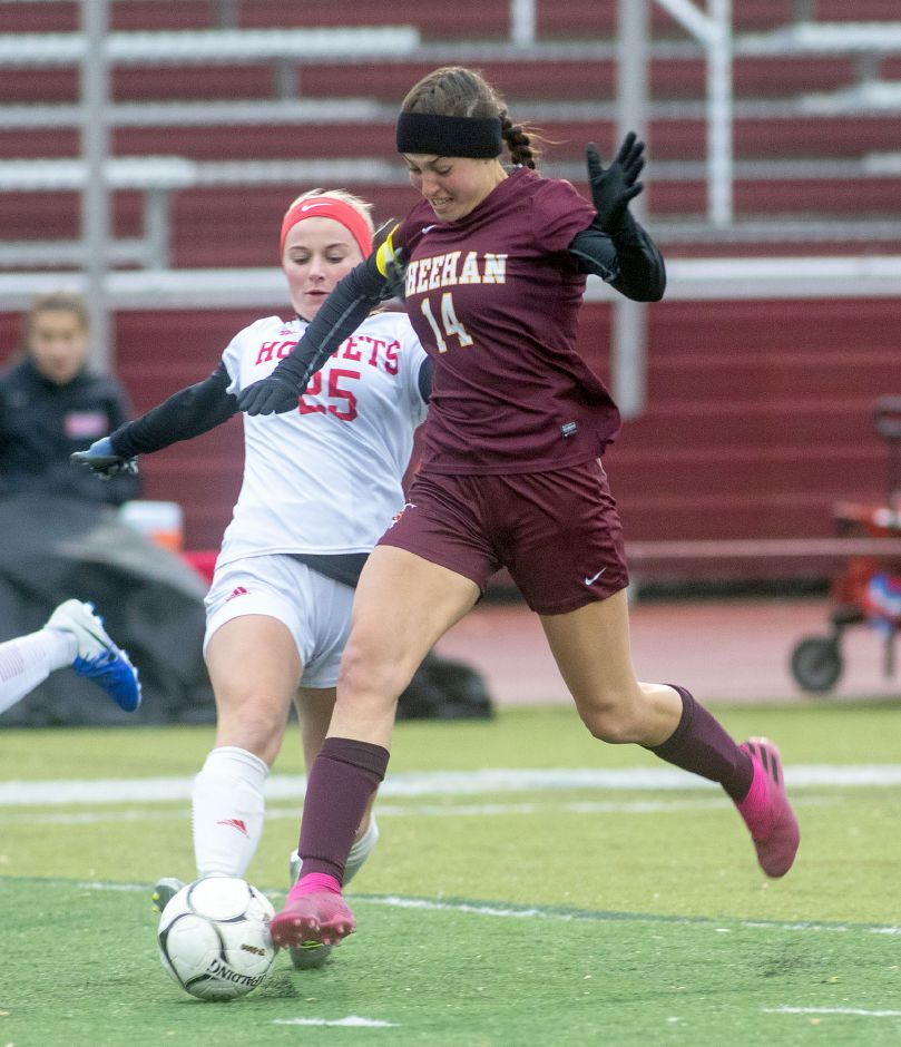 Sheehan's Olivia Dubuc battles Branford's Sydney Panczak for possession during Tuesday's first-round CIAC Class L girls soccer tournament game at Riccitelli Field. The No. 8 Titans advanced with a 2-1 victory.