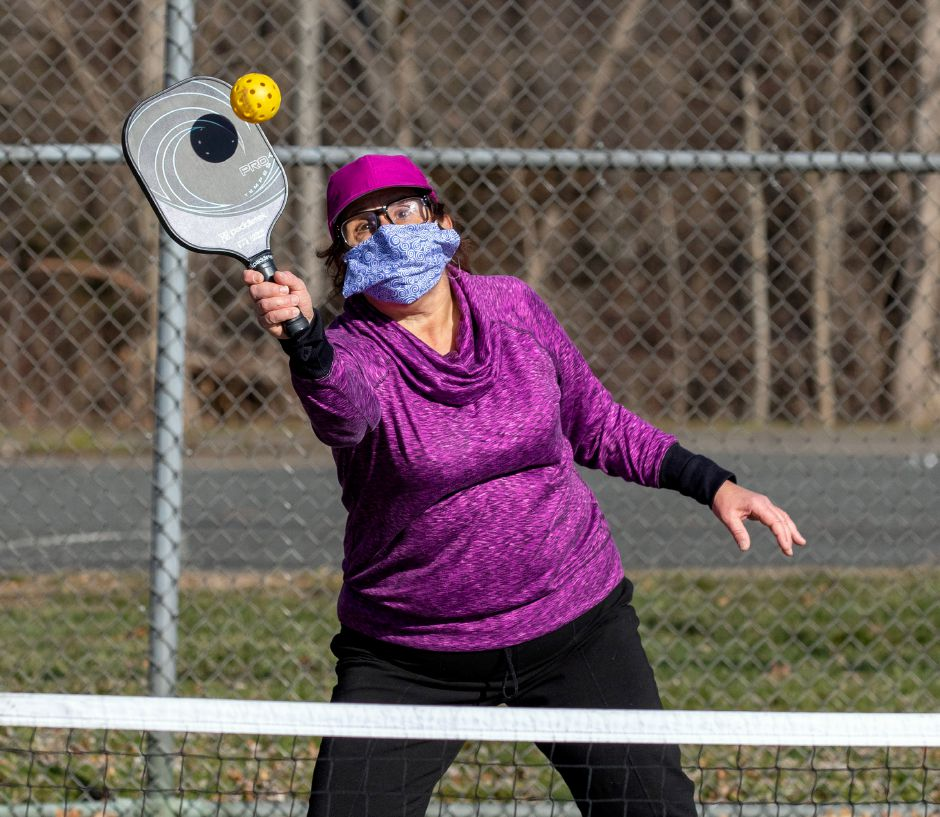 Debbie Saranitzky, of Meriden, hits the ball back over the net during a game of pickleball at Harrison Park in Wallingford on Friday, Jan. 8, 2021. Aaron Flaum, Record-Journal.com