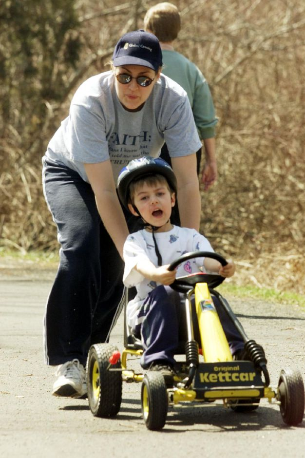Samuel Eurban, 4, gets a little help from his mother Michele Eurban while enjoying the spring like weather Monday on the Quinnipiac River Linear Trail in Wallingford April 9, 2001.