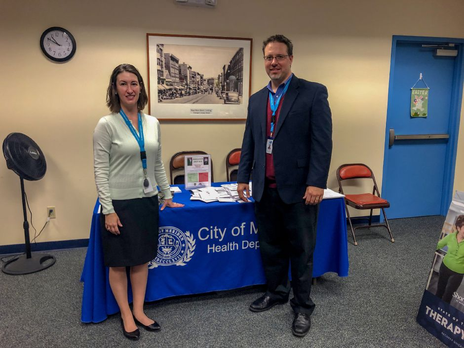 Lea Crown, MPH, Director of Health and Human Services for the City of Meriden and Rick Liegl, Senior Affairs Administrator stand in front of a table for the Meriden Health Department at the Senior Health Fair,  Wednesday, May 8, 2019 | Kristen Dearborn, Special to the Record-Journal