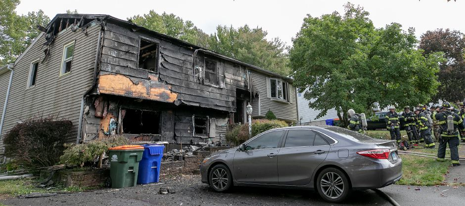 Meriden firefighters overhaul a home at 32 Spice Hill Dr. after a fire heavily damaged the residence, Monday morning, Sept. 28, 2020. Dave Zajac, Record-Journal