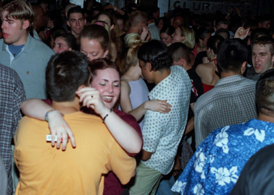 Niki Magloichetti, 20, of Wallingford dances to the beat at Club 2001 on the Berlin Turnpike Friday night June 8, 2000.