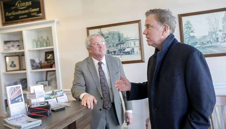 Gov. Ned Lamont visits with Jay Fishbein at J. J. Fishbein, Inc. during a tour of Wallingford, Thurs., Feb. 28 2019. Dave Zajac, Record-Journal