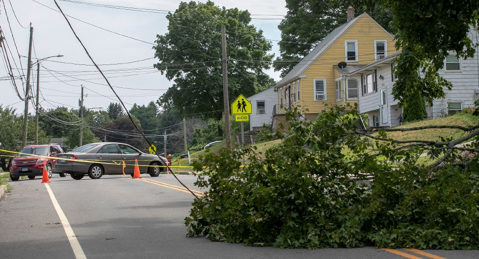 Motorists turn around due to downed wires and a fallen tree blocking part of Gravel Street in Meriden, Thurs., Aug. 6, 2020. Dave Zajac, Record-Journal
