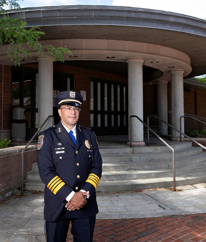 New Police Chief Roberto Rosado stands in front of the Meriden Police Department during his first day of service, Wed., Jul. 1, 2020. Rosado spent the past 22 years with the Willimantic Police Department, including four as chief. One of Rosado's top goals in Meriden will be building trust and relationships within the community. Dave Zajac, Record-Journal