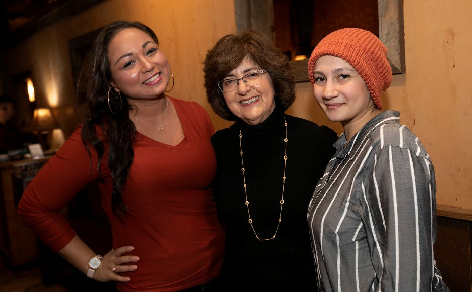 Mary Lou DiPaola, center, a recently retired ESL teacher, reunited with former students Kaoutar Tayoubi-Elidrissi, 31, of Meriden, left, and Allaa Arbach, 30, of Wallingford, at Wood-n-Tap restaurant in Wallingford on Feb. 7. DiPaola created and established the first ESL program at Washington Middle School.