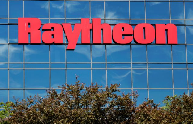 The sky is reflected on the facade of Raytheon