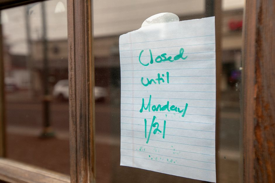 A closed sign on the front door of Caffe Del Mondo, 51 N. Main St. in Southington, Thurs. Feb. 7, 2019. Dave Zajac, Record-Journal