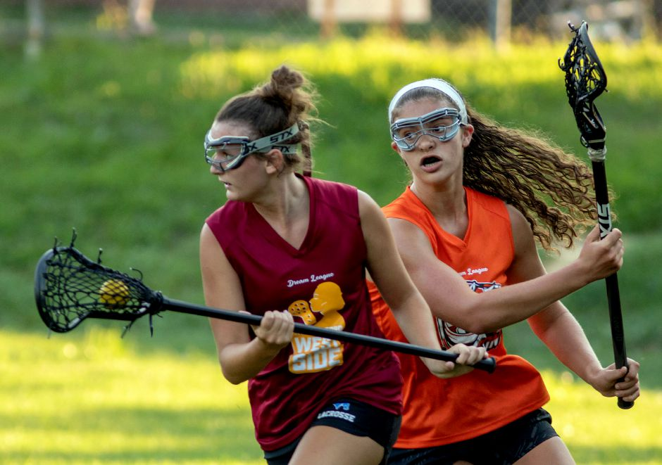 Kaylee Drobish of the Wallingford West Side breaks free from a Shelton Stag defender during a Dream League girls lacrosse game last week at Gracie Field in Shelton.