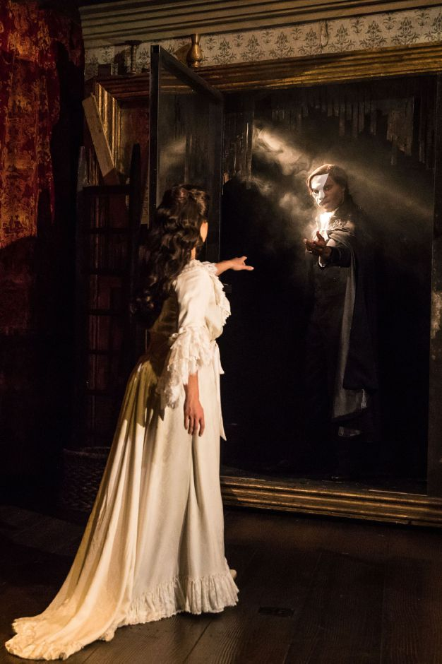 "Eva Tavares as 'Christine Daaé' and Derrick Davis as 'The Phantom' perform ""The Mirror"" in ""The Phantom of the Opera."" Photo: Matthew Murphy"