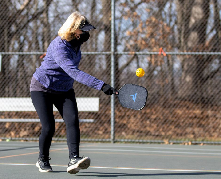 Peggy D'Andrea, of Wallingford, returns a serve during a game of pickleball at Harrison Park in Wallingford on Friday, Jan. 8, 2021. Aaron Flaum, Record-Journal.com