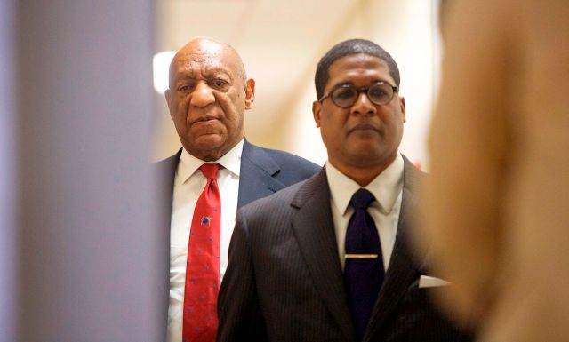 "Actor and comedian Bill Cosby, left, reacts after being notified a verdict was in in his sexual assault retrial, Thursday, April, 26, 2018, at the Montgomery County Courthouse in Norristown, Pa. A jury convicted the ""Cosby Show"" star of three counts of aggravated indecent assault on Thursday. The guilty verdict came less than a year after another jury deadlocked on the charges.  (Mark Makela/Pool Photo via AP)"