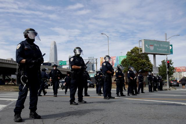 Police officers block a street near the San Francisco-Oakland Bay Bridge in San Francisco, Sunday, May 31, 2020, at a protest over the Memorial Day death of George Floyd. Floyd was a black man who was killed in police custody in Minneapolis on May 25. (AP Photo/Jeff Chiu)