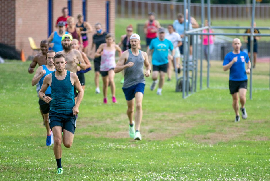 Derek Destefano leads the pack off the line on July 1 in the opening race of the 2020 Meriden Fun Run summer series at Platt High School. The series continues Wednesday night at Platt at 6:30 p.m. Aaron Flaum, Record-Journal
