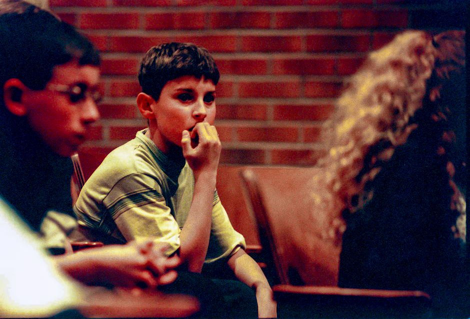 RJ file photo - Pond Hill School studen Chris Bevin bites his nails while waiting his turn during the Wallingford Spelling Bee, March 1999.