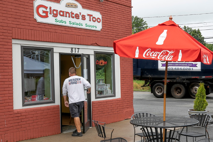 A customer enters Gigante's Too at 817 E. Center St. in Wallingford on Tuesday. Gigante's Too has reopened under new ownership.