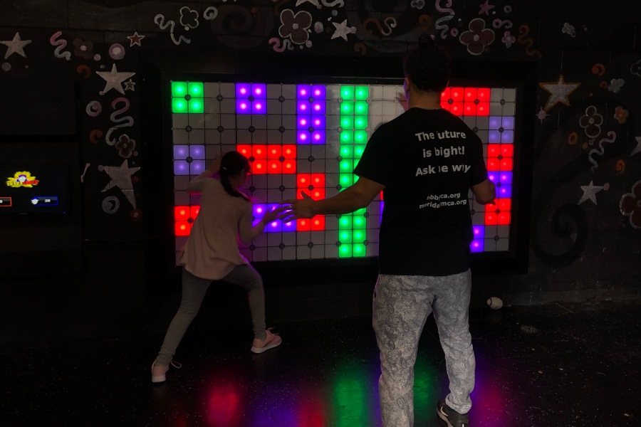 Children and staff playing a game on the Lightspace Wall in the Exergame Fitness Arcade at the Meriden YMCA. |Kristen Dearborn, Special to the Record-Journal