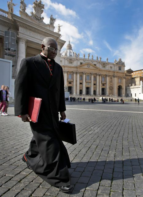 FILE - In this Monday, March 4, 2013 file photo, Cardinal Robert Sarah, of Guinea, walks in St. Peter