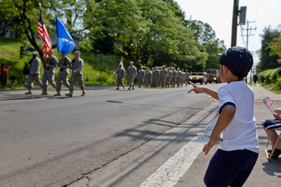 Meriden resident Muizz Naru, 4, watches the US Army Mountain Dvs. march in the Memorial Day Parade in downtown Meriden, May 28, 2012. (Justin Weekes/Record-Journal)