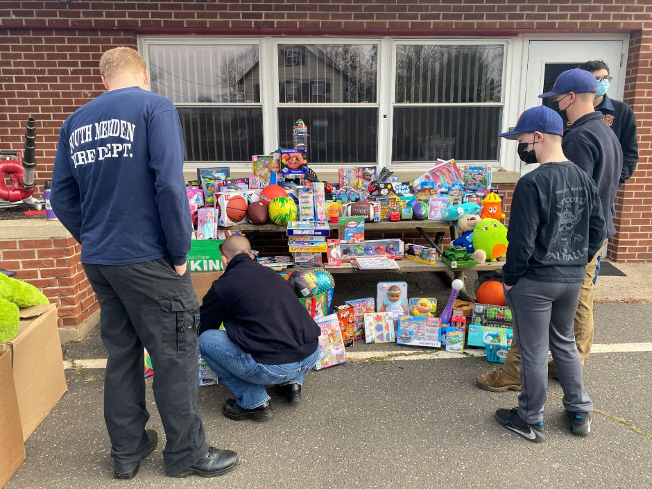 South Meriden Volunteer Fire Dept. volunteer, June Napolitano organizes and arranges the donated toys at South Meriden Neighborhood Association's Turkey and Toy Drive on Saturday, Nov. 21. | Faith Williams, Record-Journal