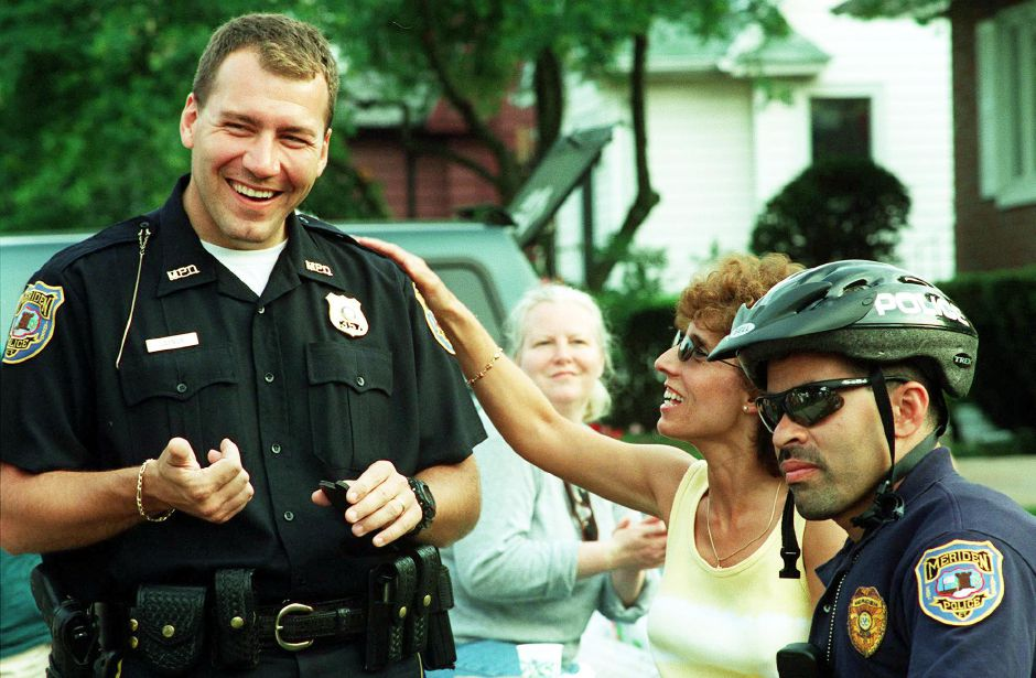 Roxanne Macri, middle, welcomes new community police officer Pat Gaynor, left, at a neighborhood party at Starlight Park on Columbus Avenue held by the Action 13 Neighborhood Association JUne 22, 2000. Officer George Gonzalez is seated at her right.