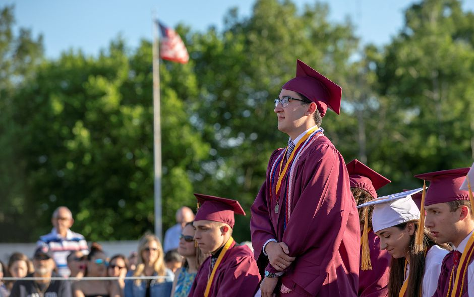 Graduate Coe Jean-Luc Bolat is recognized during a military tribute at Sheehan High School graduation ceremonies, Wed., June 12, 2019. Dave Zajac, Record-Journal
