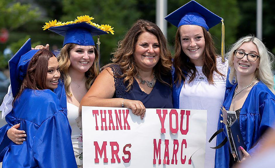 Hairdressing and Cosmetology instructor Rita Macri poses for photos with students after graduation ceremonies.