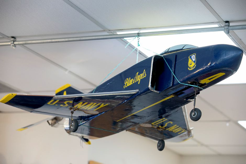 An F-4 Phantom model aircraft built by a customer hangs from the ceiling at Build Right Fly Right Hobbies.