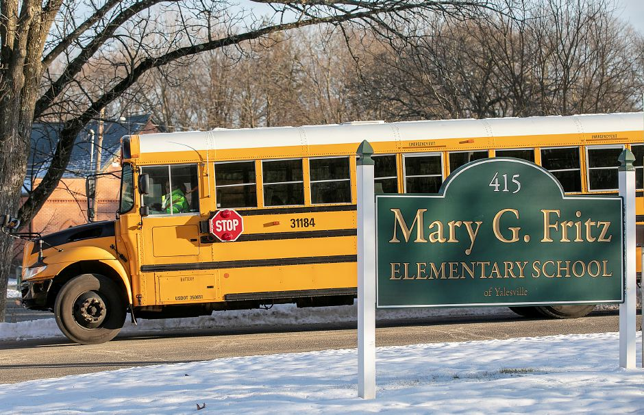 Buses leave Mary G. Fritz Elementary School at the end of the school day in Wallingford. Dave Zajac, Record-Journal