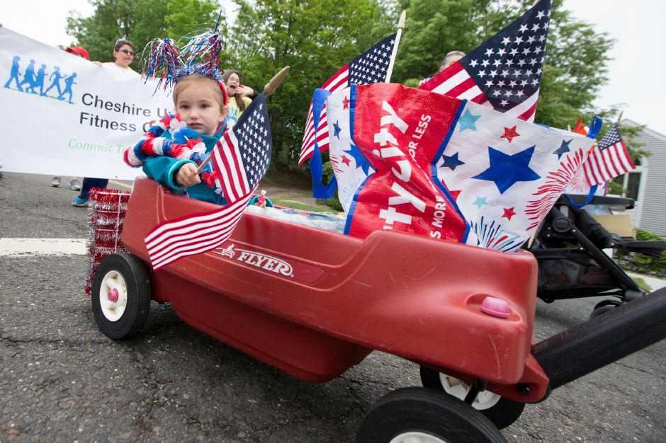 Emily Mayne 2 of Branford gets a wagon ride Sunday during the Cheshire Memorial Day Parade in Cheshire May 27, 2018 | Justin Weekes / Special to the Record-Journal