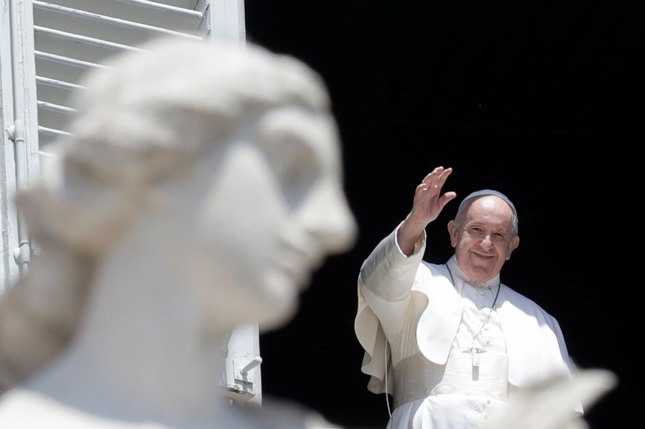 Pope Francis delivers his blessing from the window of his studio overlooking St. Peter