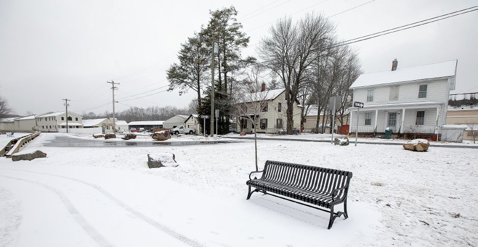 A house at 55 Railroad Ave., right, across the street from the Farnington Canal Heritage Trail in Cheshire, Mon., Feb. 18, 2019. The Town of Cheshire is considering buying the property for trail parking. Dave Zajac, Record-Journal