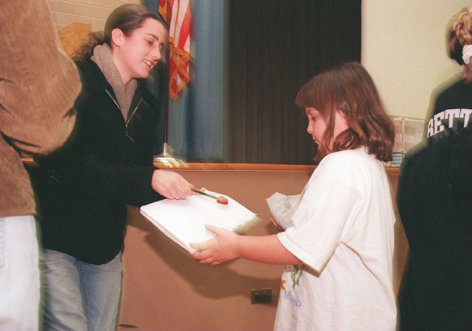 RJ file photo - Ashley Barton, left, a senior and tennis player at Choate, signs an autograph for Alexis Ercolani, a first-grader at Moses T. Beach School in Wallingford Feb. 4, 1999.